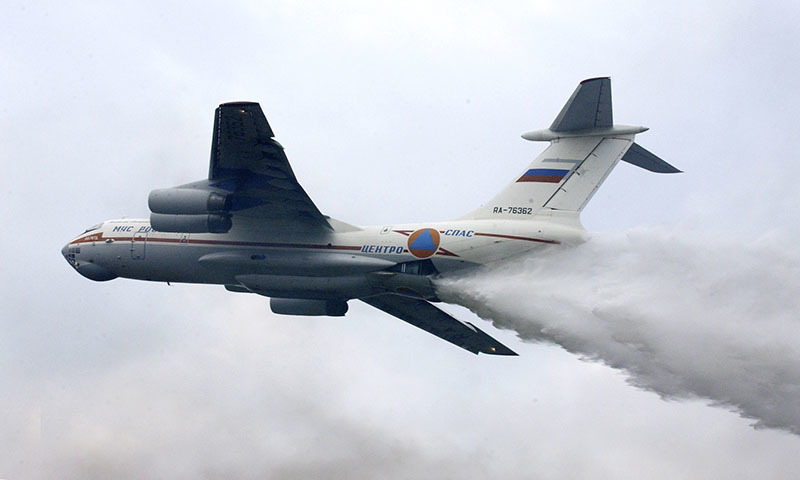 Russia's Emergencies Ministry said one of its firefighting planes with a crew of 10 has gone missing in Siberia. The ministry said the Il-76 plane disappeared Friday, July 1, 2016,  while on a mission to fight forest fires in the Irkutsk region.  The plane in this photo is the same model but not the one which went missing. — AP