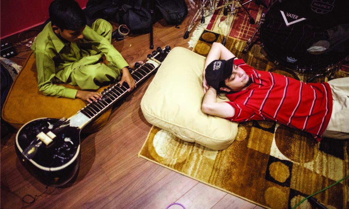 Sounds of Kolachi's Faraz Anwar takes a break during rehearsals at the Elektric Room, a studio run by Bilal Brohi| Mohammad Ali, White Star