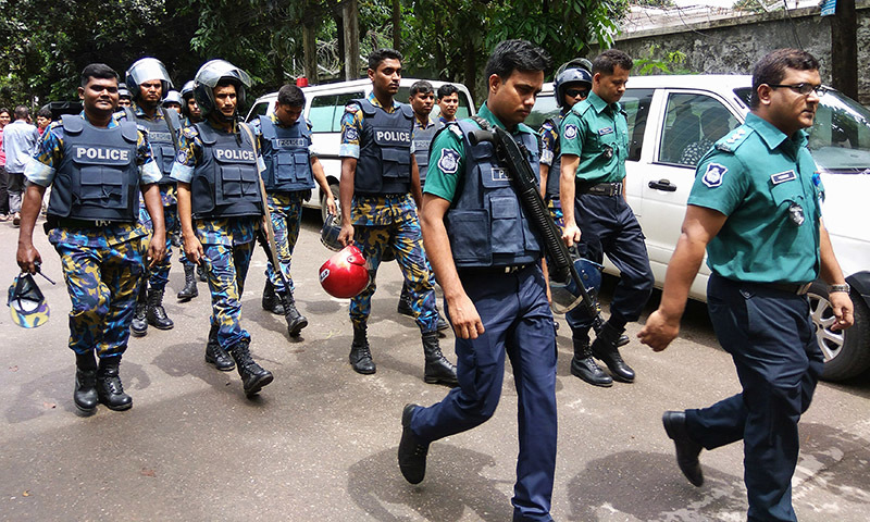 Security personnel are seen near the Holey Artisan restaurant hostage site, in Dhaka, Bangladesh, July 2, 2016.— Reuters
