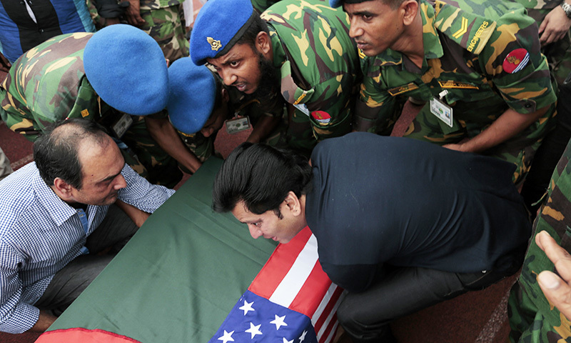 Soldiers help relatives of Abinta Kabir, student of Emory University of US, carry her coffin, which is draped in both the Bangladesh and US flags, after a ceremony to pay tribute to the victims of the attack on the Holey Artisan Bakery in Dhaka. ─ AP