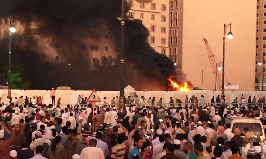 Worshippers gather after a suicide bomber detonated a device near the security headquarters of the Prophet's (PBUH) Mosque. —Reuters