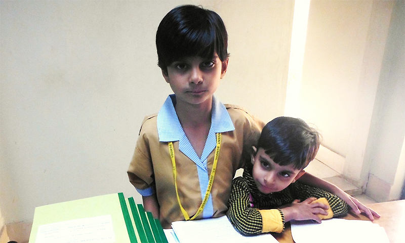 Rabab Ali, with her younger brother. Photo by Qazi Ali Athar