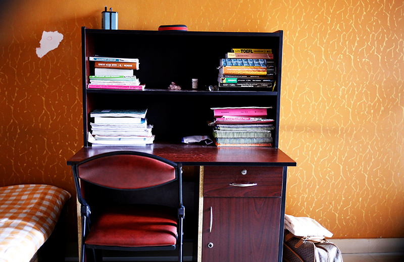 The study table of Meer Saameh Mubasheer is pictured in his room at his family home, in Dhaka. — Reuters