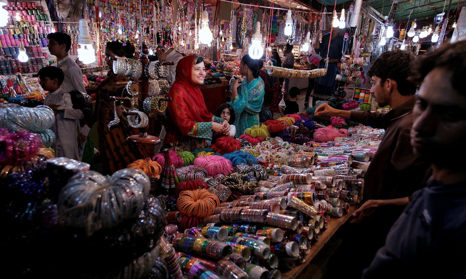 ISLAMABAD: A woman buys bangles and jewellery at a stall ahead of Eidul Fitr on Tuesday. —REUTERS/Faisal Mahmood