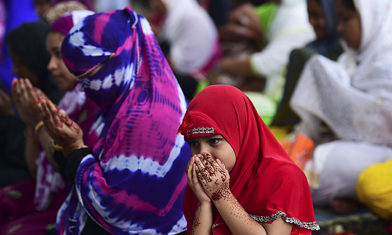 Bangladeshi Muslims offer Eidul Fitr prayers in Dhaka on July 7.— AFP
