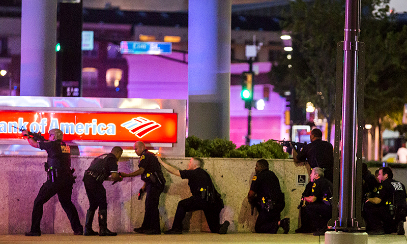 Dallas Police respond after shots were fired at a Black Lives Matter rally in downtown Dallas on Thursday, July 7, 2016. ─ AP/The Dallas Morning News