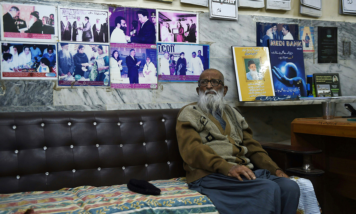 Abdul Sattar sits in his office. —AFP