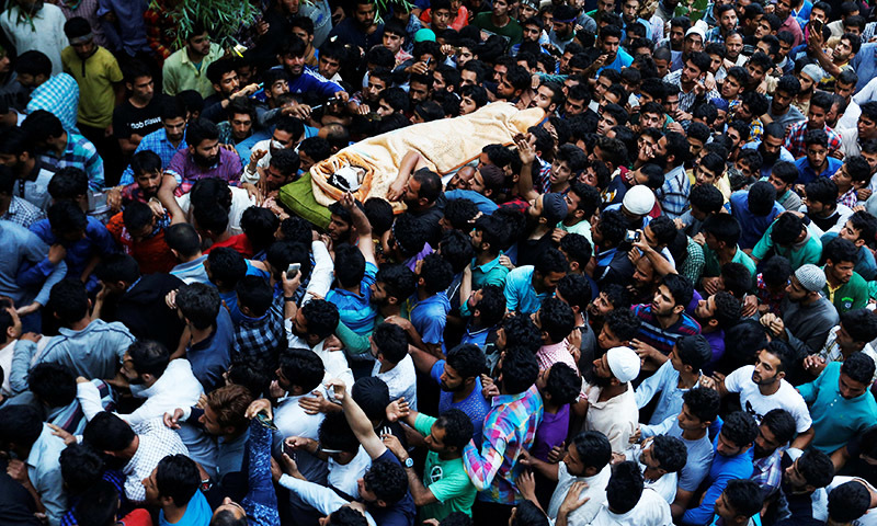 Kashmiri Muslims carry the body of Burhan Wani, a separatist militant leader, during his funeral in Tral, south of Srinagar. —Reuters