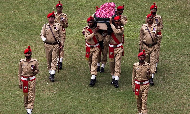 Pakistani soldiers carry the coffin containing the body of Abdul Sattar Edhi.— AP