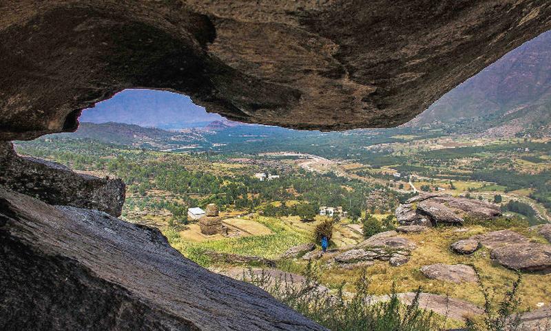 A view of the Balokaley vihara from a cave at Kandak valley in Barikot, Swat. — Dawn photo