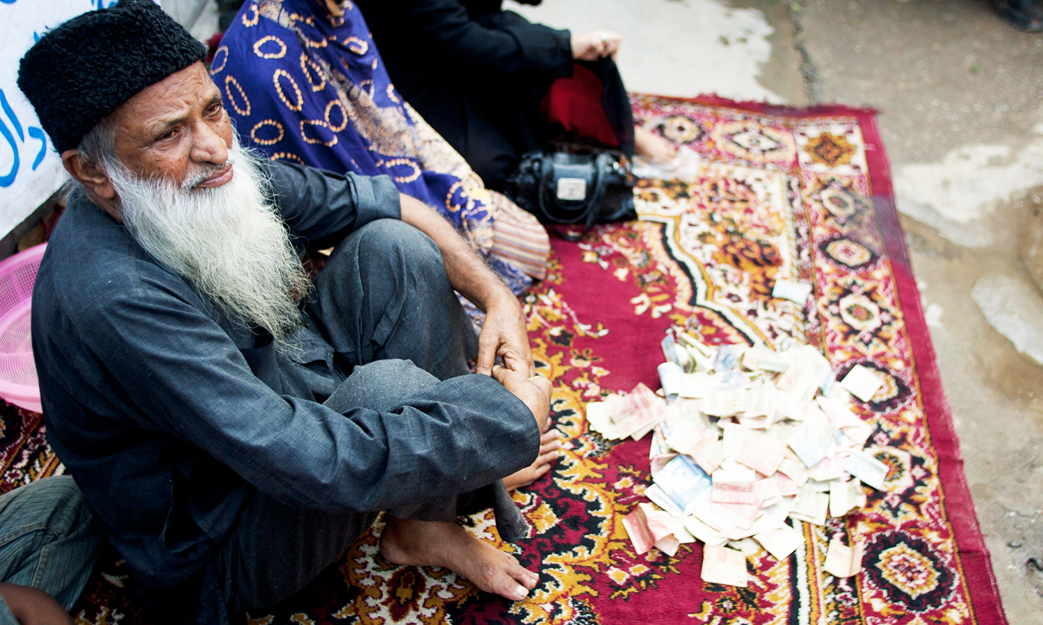 Abdul Sattar Edhi collects donations at a roadside in Peshawar. — AP Photo