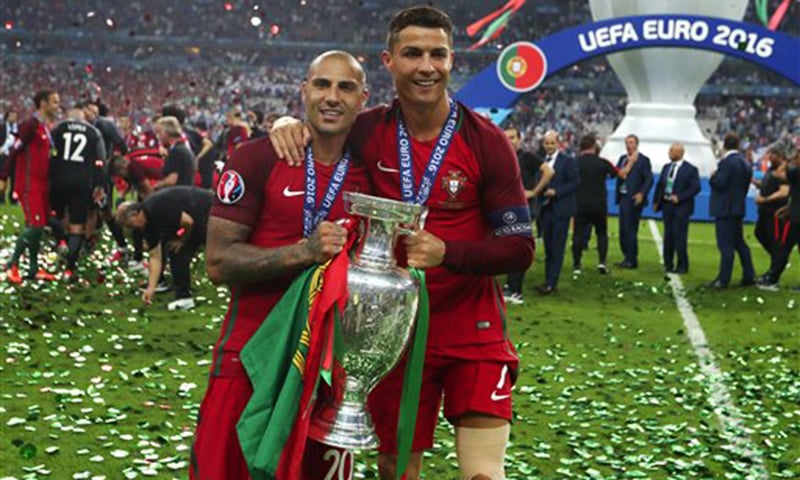 Portugal's Cristiano Ronaldo, right holds the trophy with Ricardo Quaresma after the Euro 2016 final between Portugal and France. —  AP