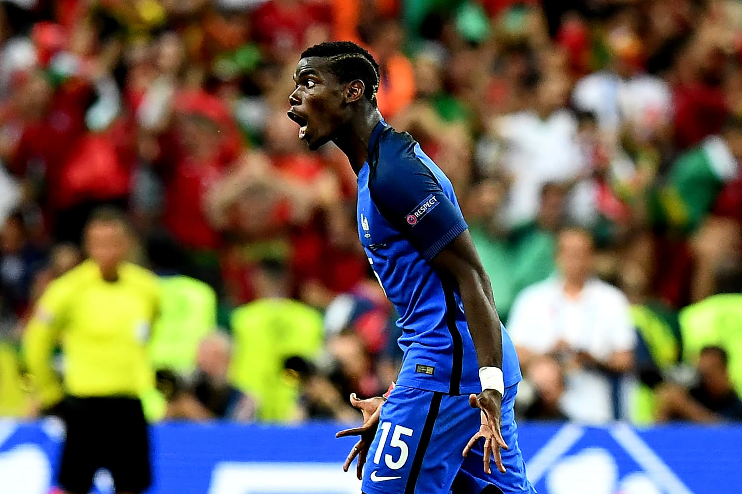 Paul Pogba reacts when the going gets tough for France in the last minutes of the match. — AFP