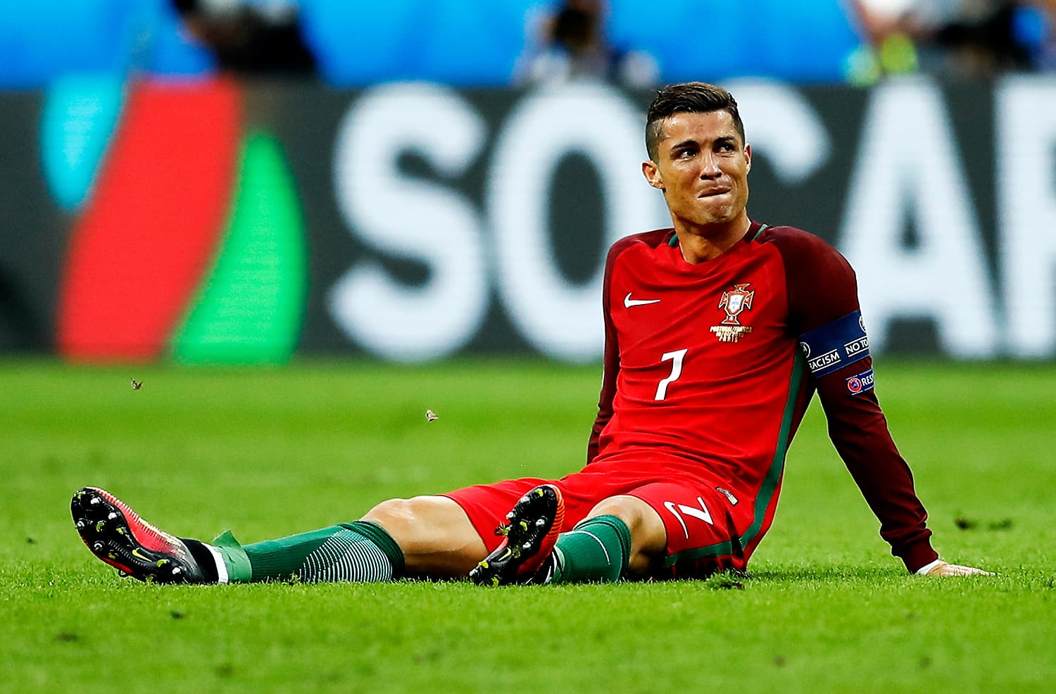 Ronaldo sits on the pitch dejected after a challenge by France's Dmitri Payet. — AP