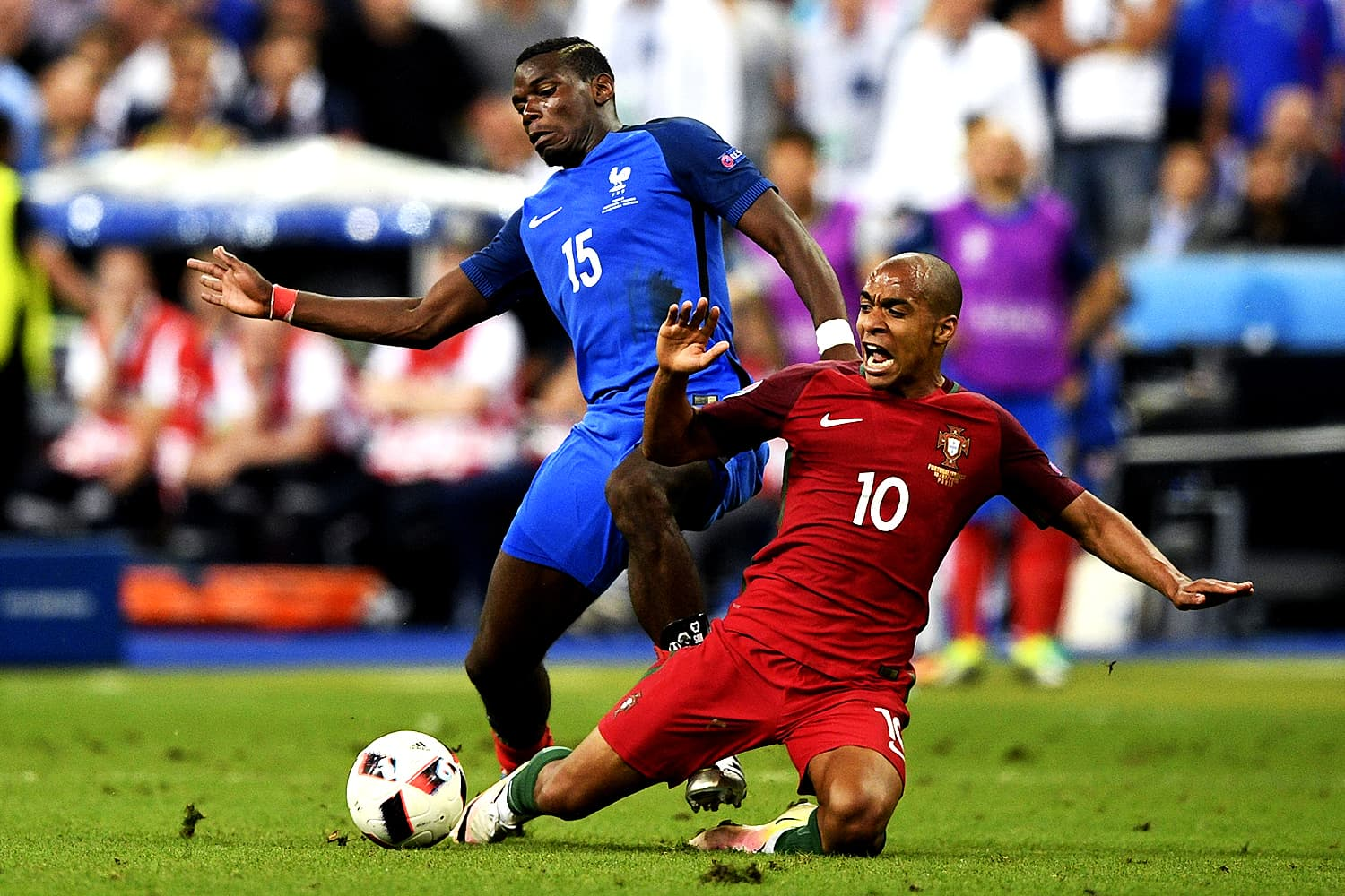France's midfielder Paul Pogba (L) vies for the ball against Portugal's midfielder Joao Mario during the Euro 2016 final football match between France and Portugal at the Stade de France in Saint-Denis. — AFP
