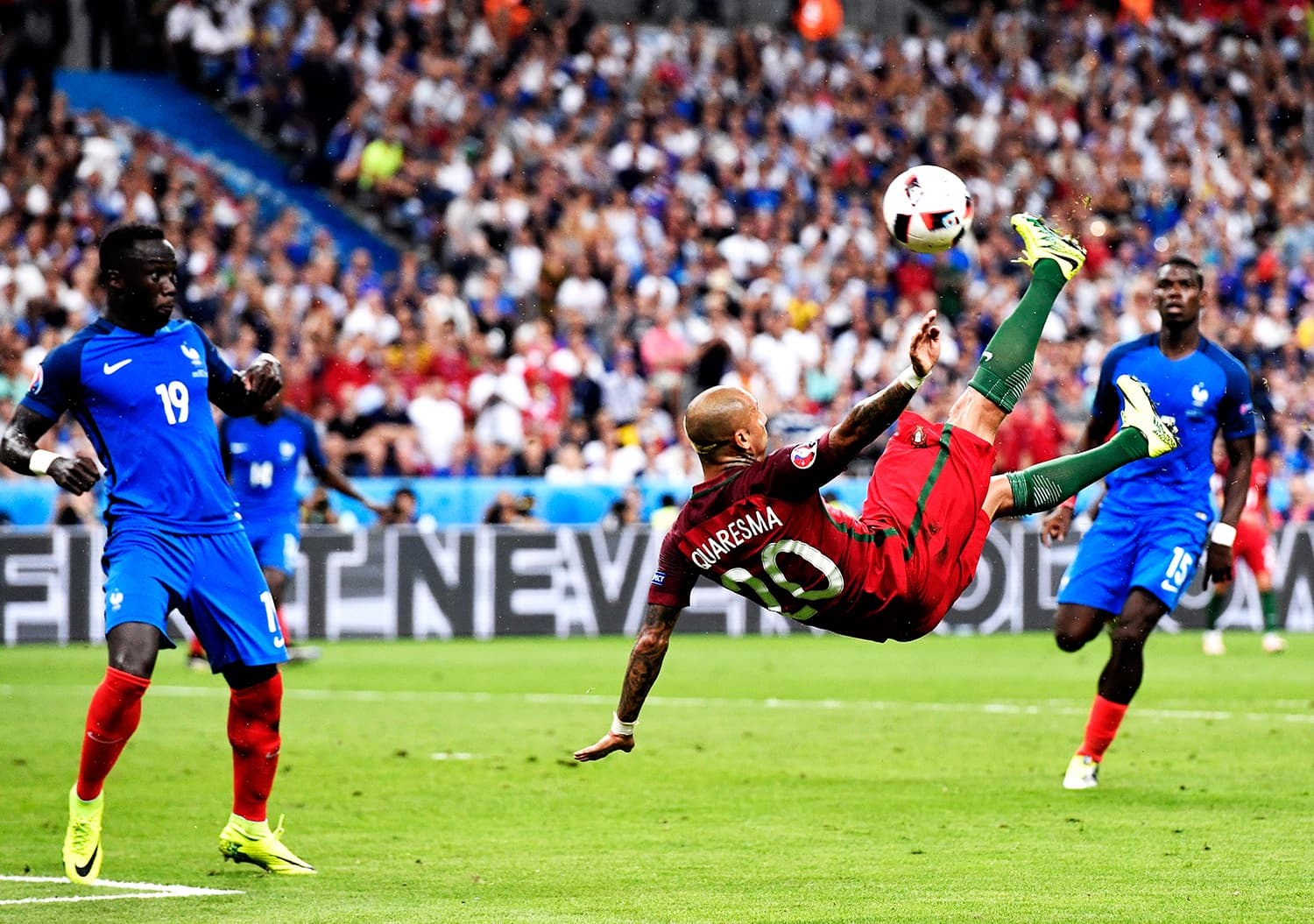 Portugal's Ricardo Quaresma makes an extravagant bicycle kick attempt on France's goal. — AP