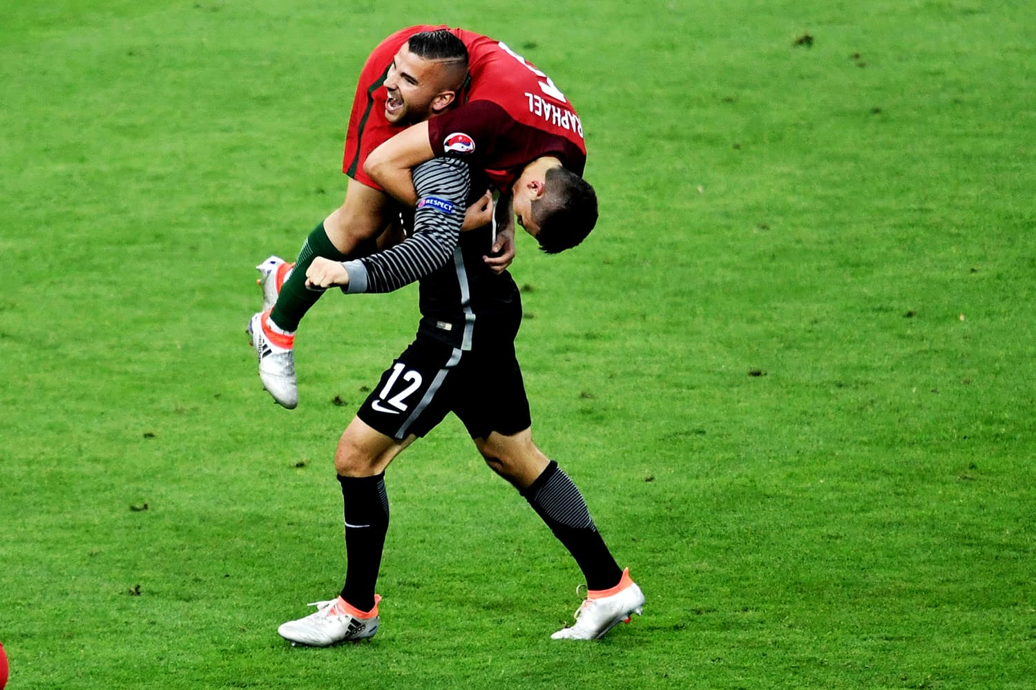 Portugal's goalkeeper Anthony Lopes and Portugal's defender Raphael Guerreiro celebrate. — AFP