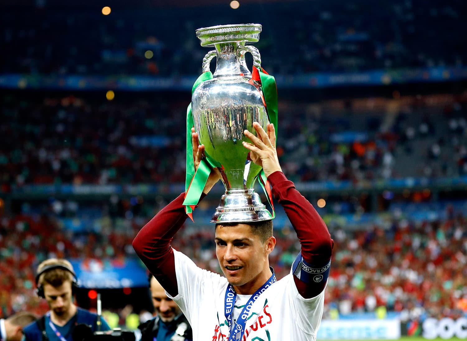 Ronaldo places his maiden European Championship trophy on his head. — AP