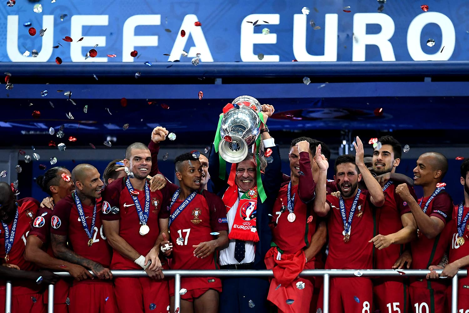 Portugal players and coach celebrate with the European Championship trophy. — AFP