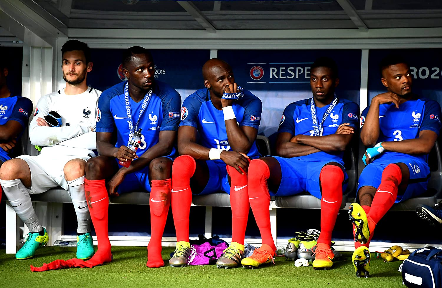 France players look on in dejection after losing the Euro 2016 final. — AFP