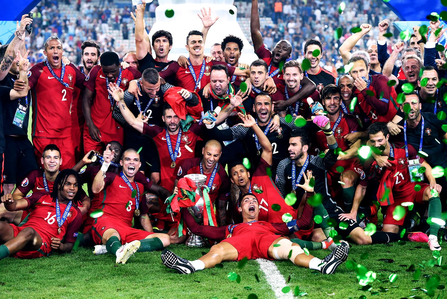 Portugal players pose with the Euro 2016 trophy. — AFP