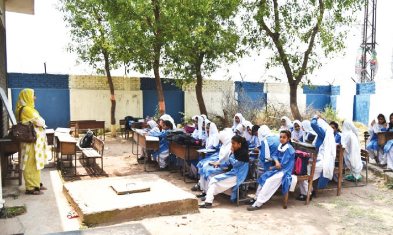 Students in many schools in Islamabad study in the open due to lack of classrooms. — File photo