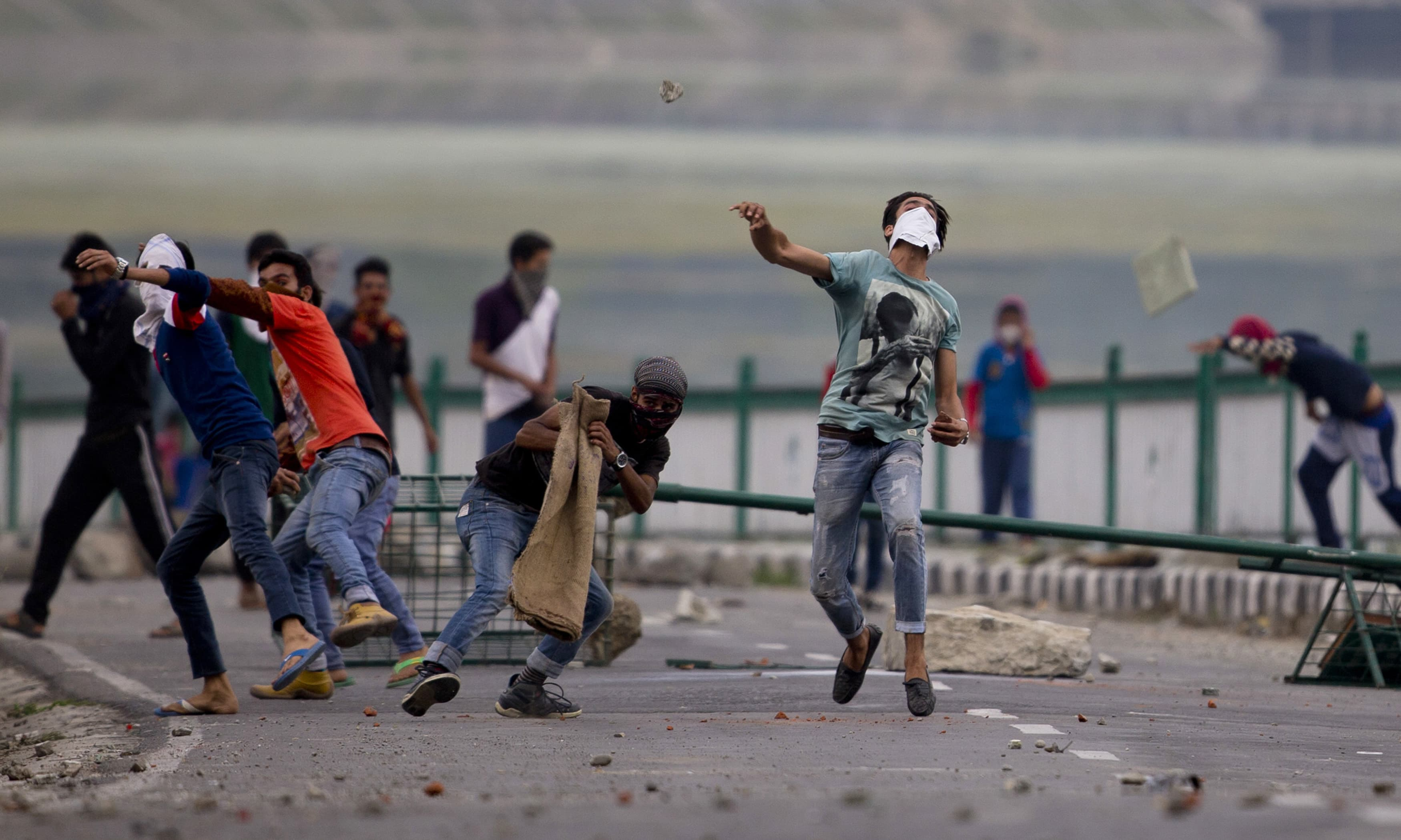 Kashmiri protesters throw stones at Indian troops in Srinagar. —AP