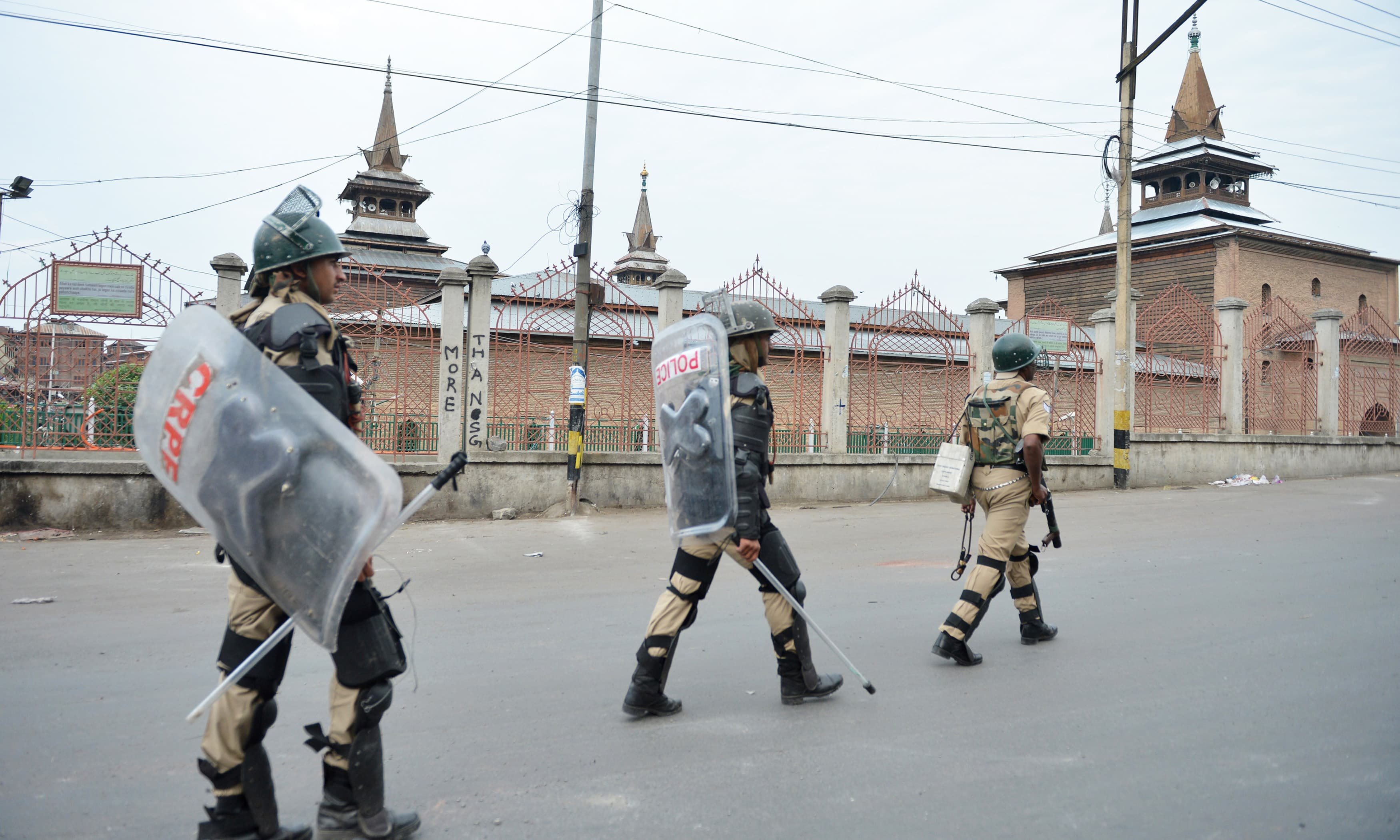 Indian paramilitary troopers patrol near the Jamia Masjid during a curfew in Srinagar. —AFP