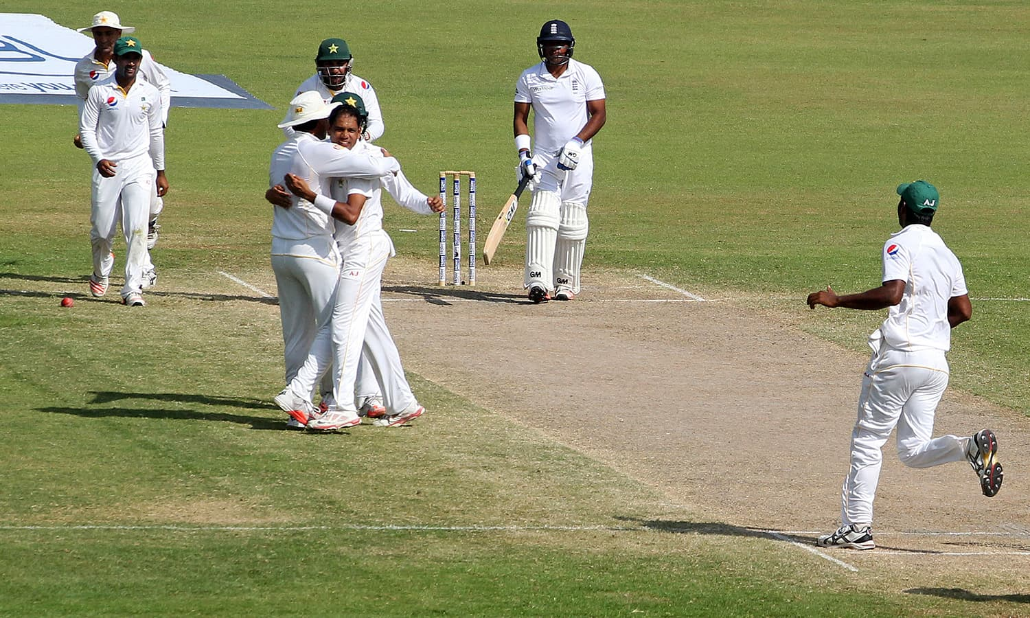 Zulfiqar Babar celebrates the wicket of England's Samit Patel. — Reuters