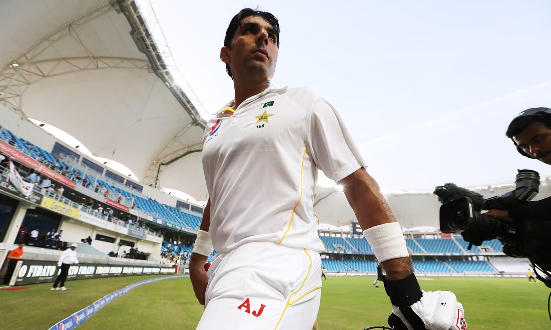 Misbah-ul-Haq walks off at the end. — Reuters