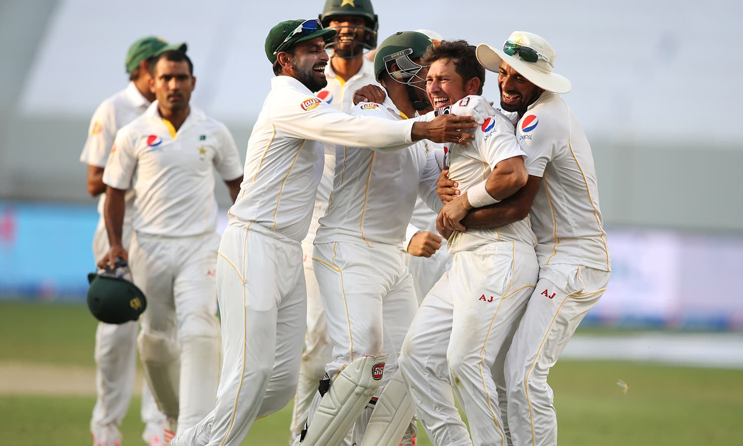 Pakistan's players celebrate with their team-mate Yasir Shah. — AP