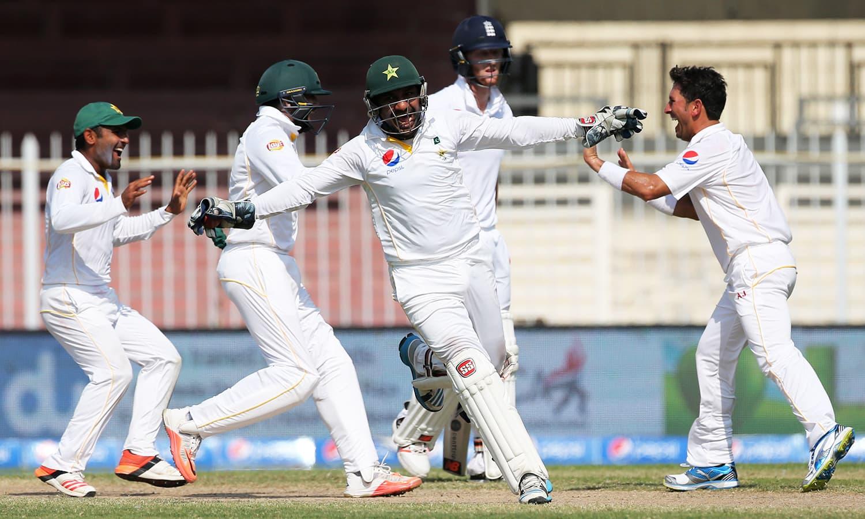Sarfraz Ahmed celebrates a wicket. — Reuters