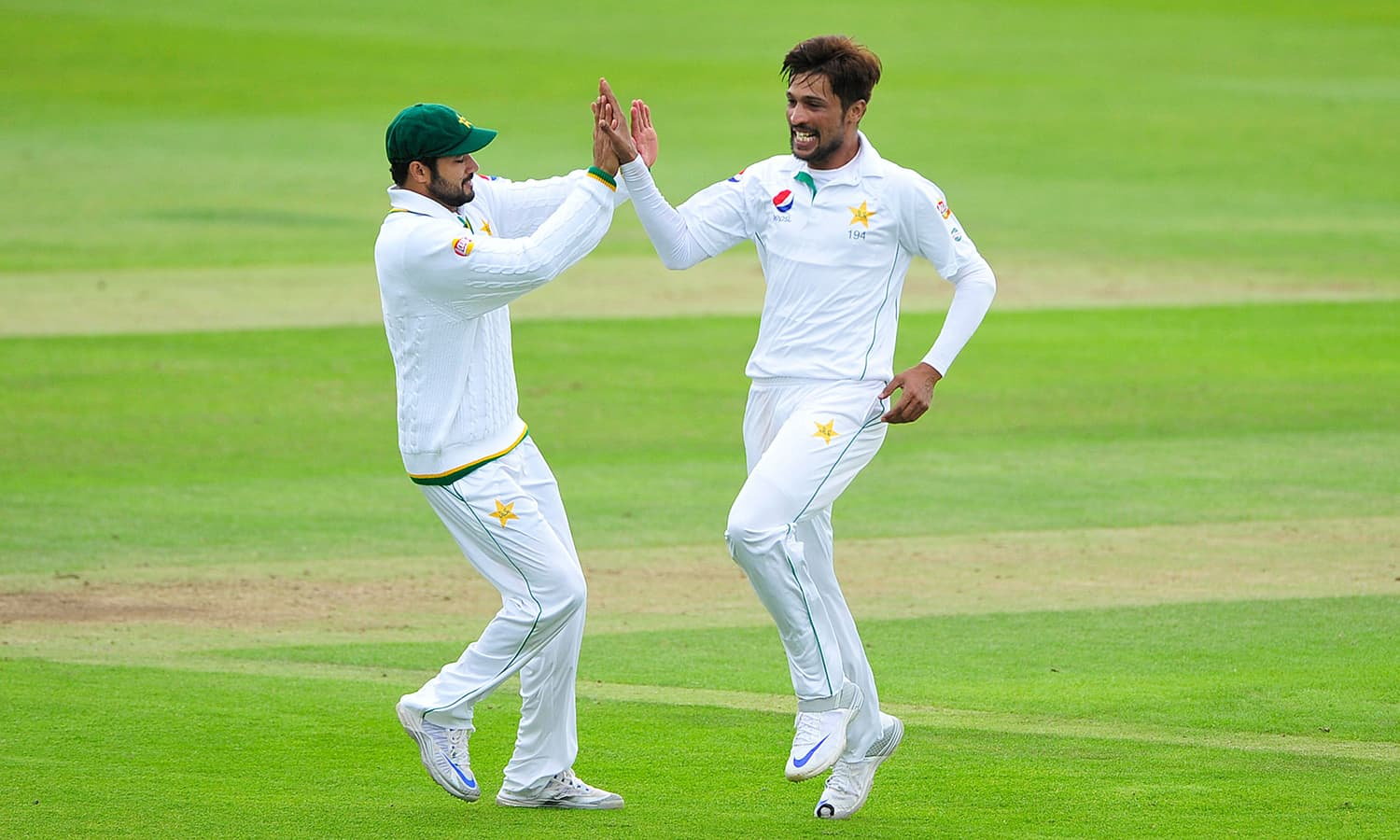 Mohammad Amir celebrates taking a wicket. — AP