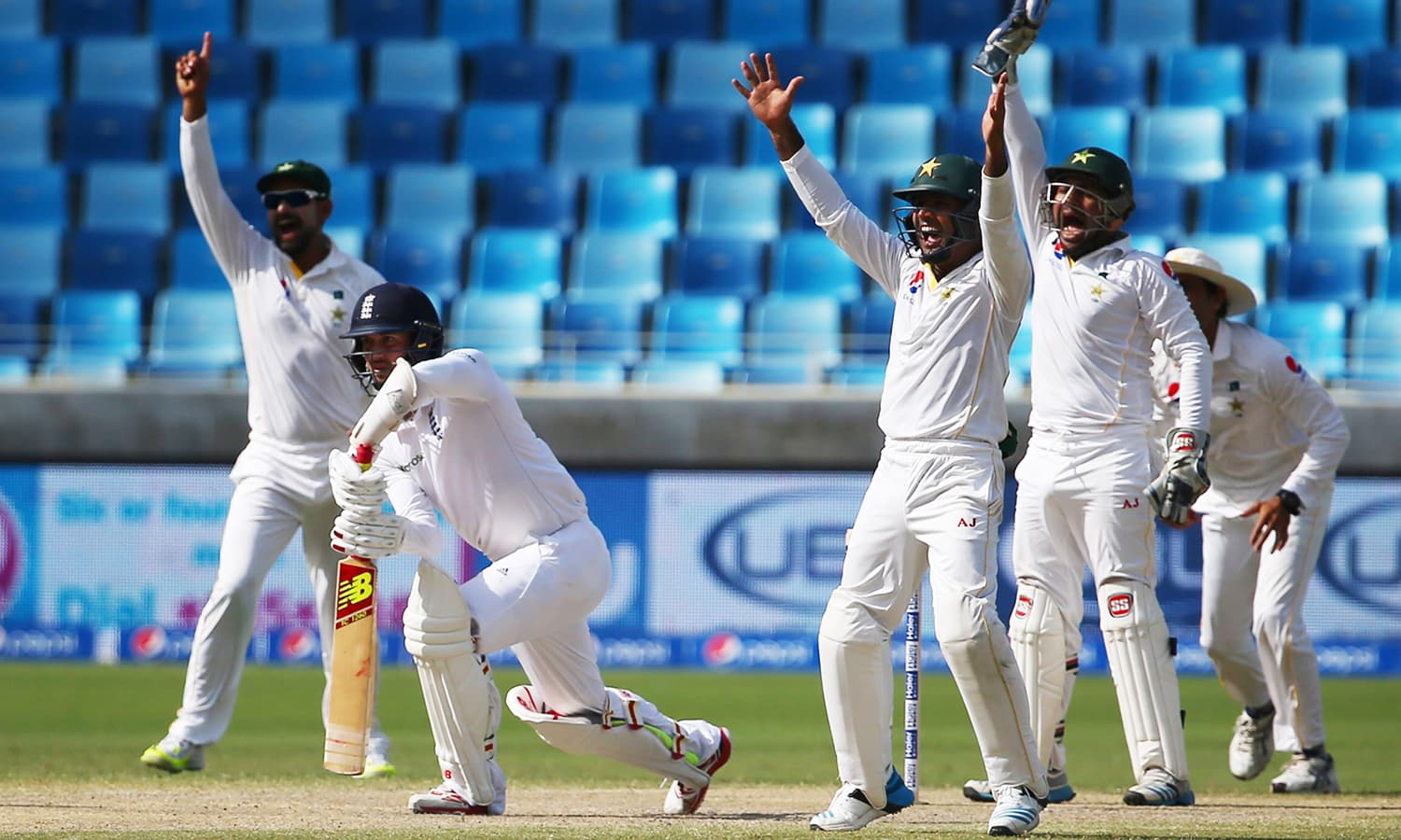 Pakistan players appeal for a wicket. — AFP