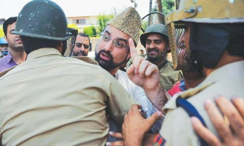 SRINAGAR: Indian police detain the author (Mirwaiz Umar Farooq) outside his residence on Wednesday.— AFP