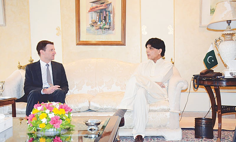 ISLAMABAD: Interior Minister Chaudhry Nisar Ali Khan talks to US Ambassador David Hale during a meeting on Thursday.—APP