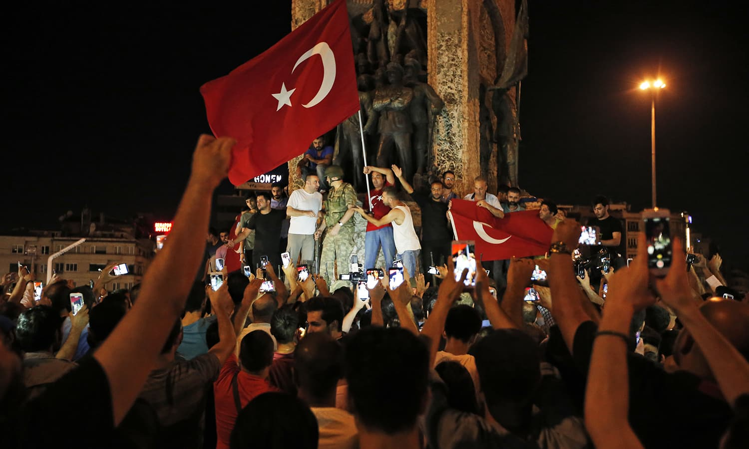 Supporters of Turkey's President Recep Tayyip Erdogan, gather, waving Turkish flags, in Istanbul's Taksim square, early Saturday, July 16. � AP