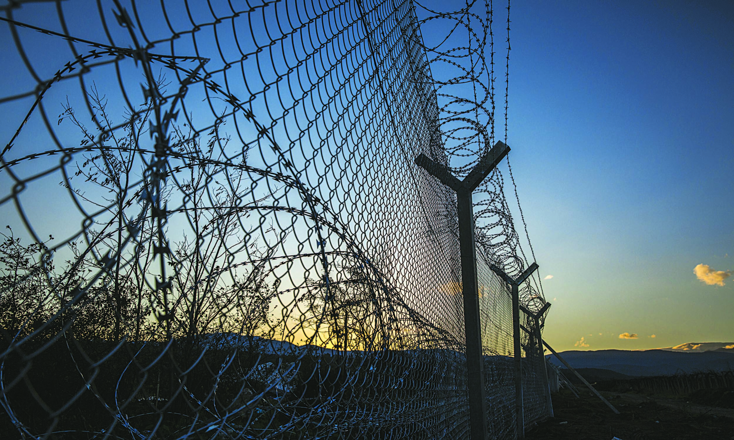 Barbed wire fence at the Greece-Macedonia border to keep migrants and refugees out | Jodi Hilton