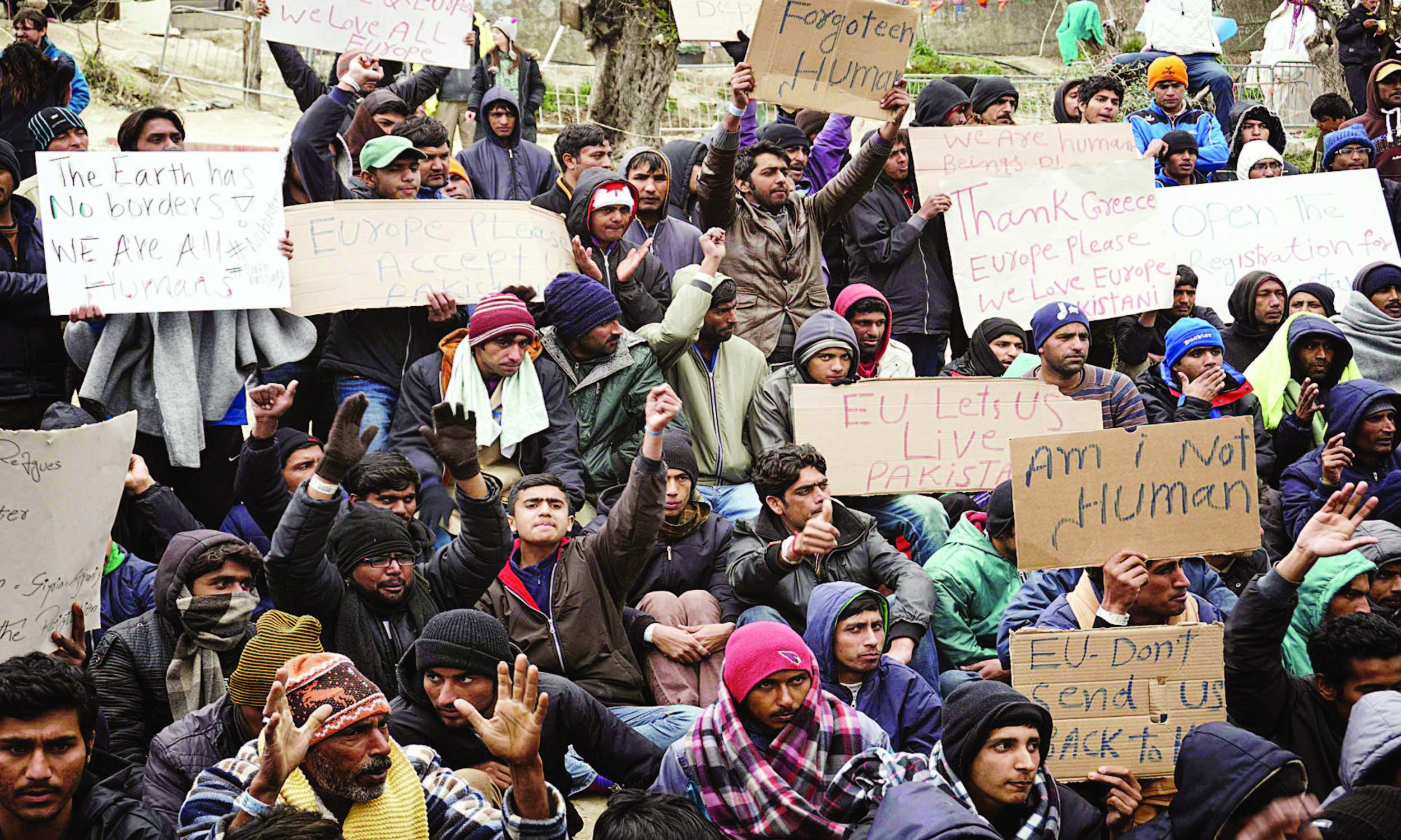 Pakistani migrants protest against deportation outside Moria detention centre at the Greek island of Lesbos in March 2016 | AFP