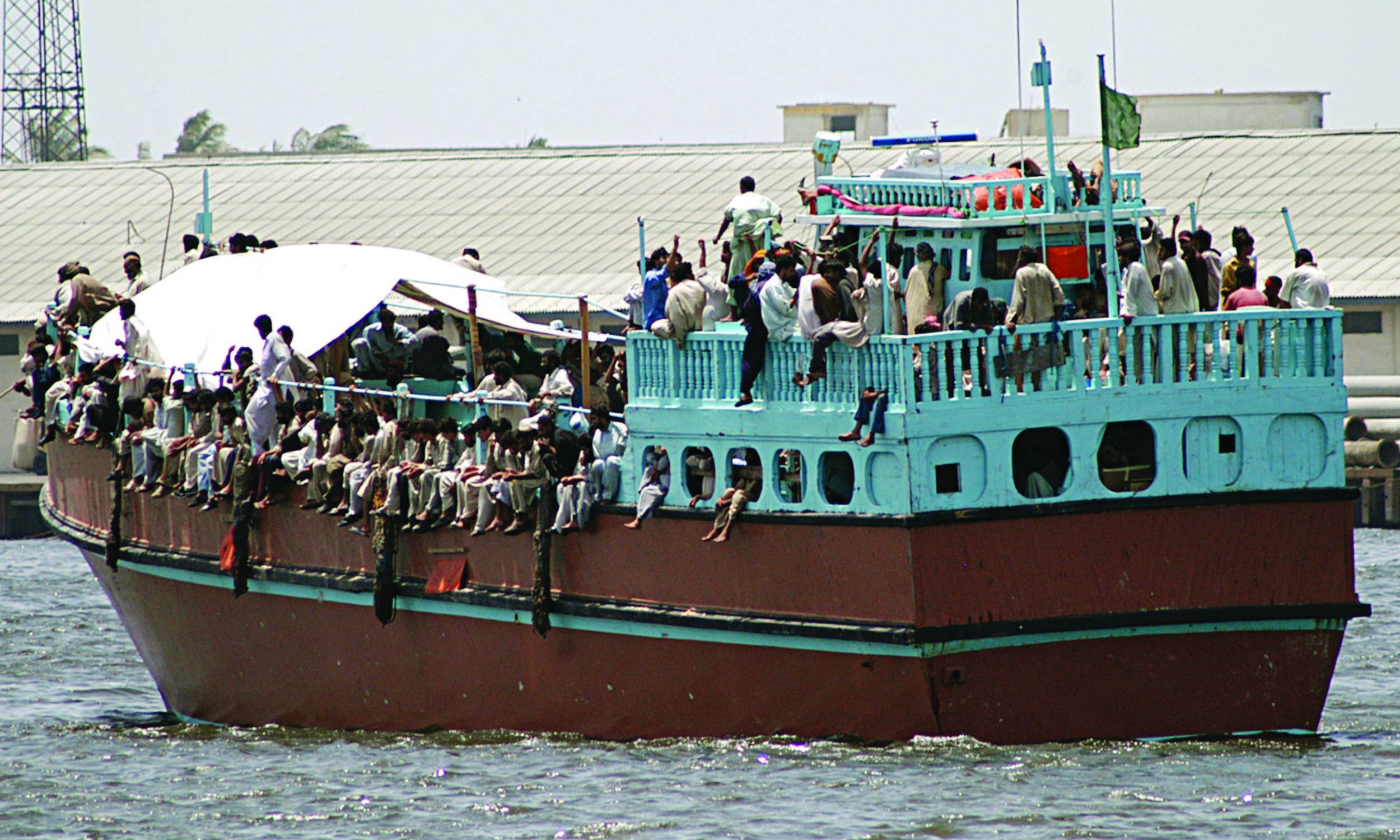 Migrants deported from Oman arrive in Karachi in 2005 | AP