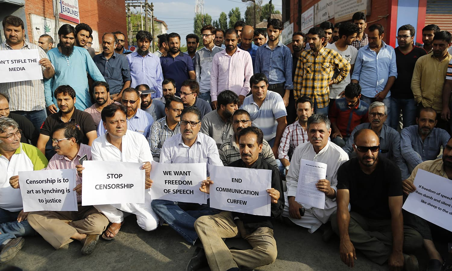 Kashmiri journalists hold placards as they protest against the government in Srinagar, India- held Kashmir.─AP