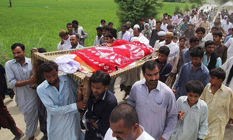 Relatives and residents carry the coffin Qandeel Baloch during her funeral in Shah Sadar Din village, around 130 kilometers from Multan. —AFP