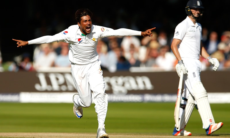 Pakistan's Mohammad Amir celebrates taking the wicket of England's Stuart Broad. — Reuters