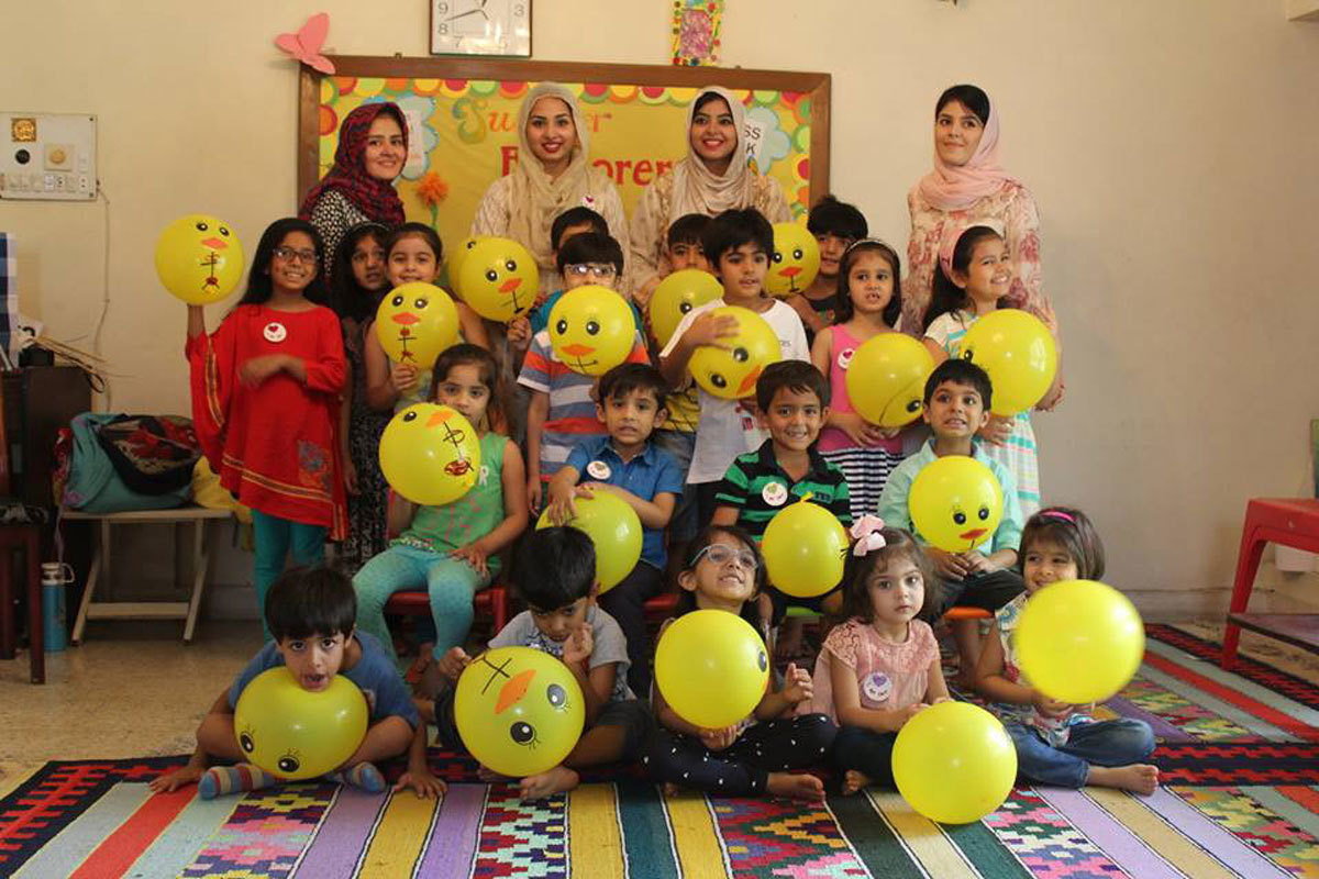 Maham and Mehr with teachers and children of summer camp Summer Explorers. Photo: Facebook
