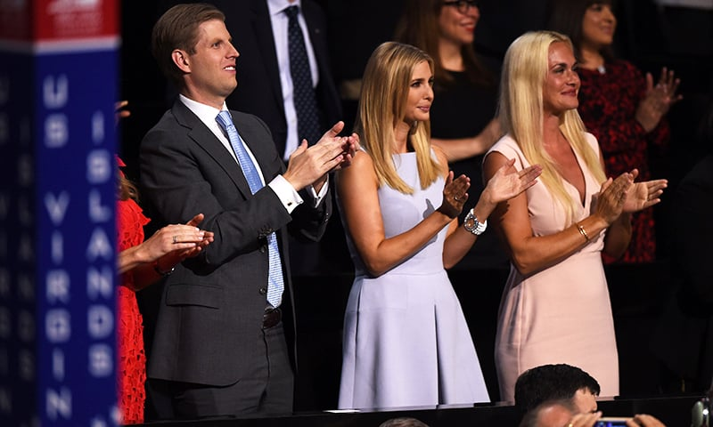 Donald Trump's son Eric and his wife Vanessa (R) and daughter Ivanka (C) clap on the second day of the convention.— AFP