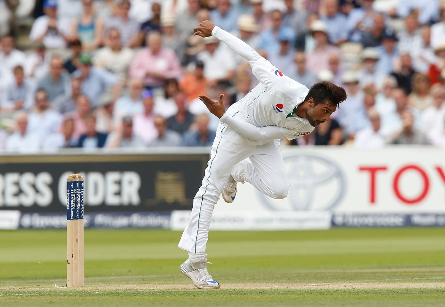 Pakistan's Mohammad Amir completes his run-up. — AFP
