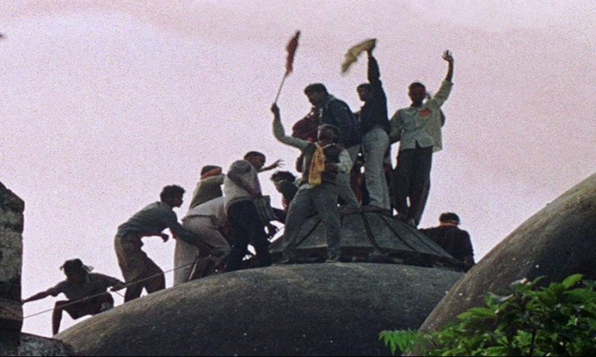 Hindu extremists demolish Babri mosque in Ayodhya, triggering widespread Hindu-Muslim violence in 1992   AFP