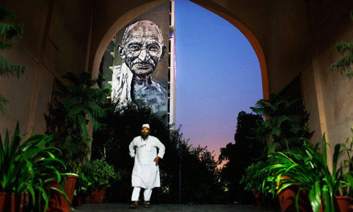 how oppressed are muslims in in review herald an n muslim man walks into a mosque in new delhi a portrait of mahatma
