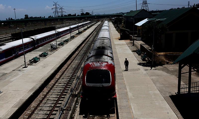 An Indian policeman walks next to a parked train on a deserted platform at Budgam railway station during a curfew in Srinagar. � Reuters