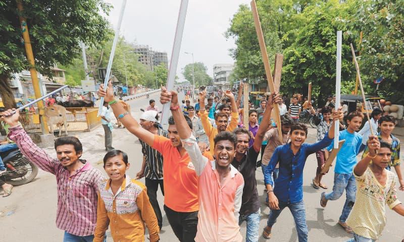 Protests erupt in Modi's state over attack on low-caste men
